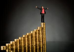 http://pas-wordpress-media.s3.amazonaws.com/wp-content/uploads/2013/08/Man-Standing-on-Stack-of-Coins-1024x726.jpg